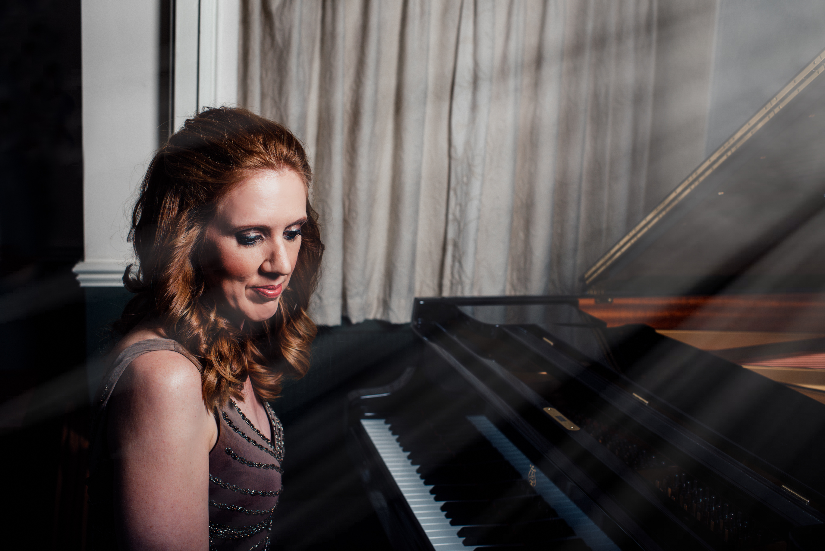 Sarah Beth Briggs seated at the piano